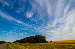 Blue sky with traces of planes Royalty Free Stock Photos