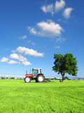 Blue sky and tractor Royalty Free Stock Photo