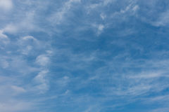 Blue sky with translucent watercolor-like clouds at daytime Royalty Free Stock Photography
