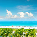 Blue sky, turquoise water, palm trees. Miami Beach, Ocean Drive Royalty Free Stock Photo