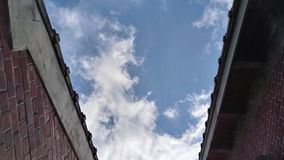 Blue sky between two old houses, taiwan royalty free stock image