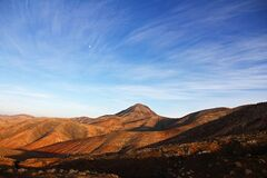 Blue Sky Under Brown Mountain Stock Photography