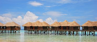 Blue Sky Vacation Of A Life Time On Overwater Bungalow At A Tropical Beach Resort Island, Maldives Stock Photos
