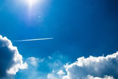 Blue Sky view with Clouds and a Jet trail royalty free stock photos