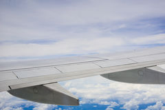 Blue sky view over the wing of the plane Royalty Free Stock Photography