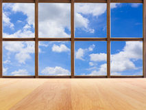 Blue sky view from wooden window Stock Photography