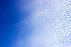 Blue Sky Vignette with Dotted Broken Clouds Royalty Free Stock Images