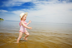 Blue Sky, Water And Running Child Royalty Free Stock Image