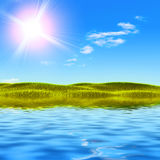 Blue sky with water and autumn grass Royalty Free Stock Photos