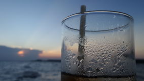 Blue sky and Water on cold water glass under sunset Royalty Free Stock Photography