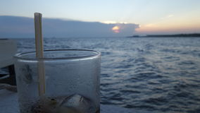 Blue sky and Water on cold water glass under sunset Stock Images
