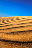 Blue sky on the waves of sand. Blue sky on the waves of sand Royalty Free Stock Photos
