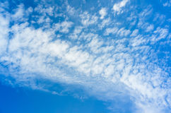 Blue sky with white altocumulus clouds at daytime. Background photo texture Royalty Free Stock Photos