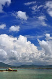 Blue sky and white cloud. It is a landscapes of Sanya, Hainan. The sky and the cloud is so beautiful Stock Photo