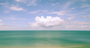 Blue sky and white cloud over the sea. Photo background of blue sky and white cloud over the sea Stock Photo