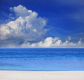 Blue sky white cloud and sand beach Royalty Free Stock Photo