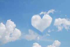 Blue sky and white clouds. Blue sky and cloud in the form of heart as a symbol of love Stock Image