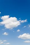 Blue sky with white clouds. Blue sky with white fluffy clouds (portrait Royalty Free Stock Photography