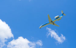 Blue sky, white clouds and airplane Stock Photos