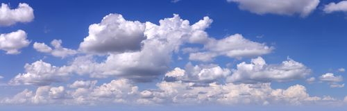Blue sky with white clouds as background Royalty Free Stock Images