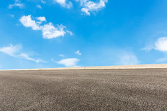 Blue sky white clouds and asphalt road Stock Photos