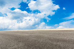 Blue sky white clouds and asphalt road Royalty Free Stock Photography