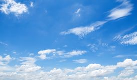 Blue sky with white clouds background. Beautiful, nature, beauty, color, summer, pattern, light, bright, day, environment, high, weather, scenic, air, heaven stock images