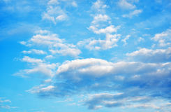 The blue sky and white clouds background. Royalty Free Stock Images