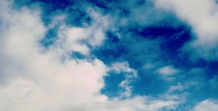 Blue sky and white clouds. Background Royalty Free Stock Image