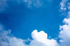 Blue sky with white clouds for background and copy space Stock Photos
