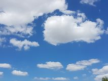 Blue sky with white clouds. Landscape Royalty Free Stock Photos