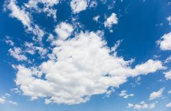 A cotton-like sky, a blue, clear sky, a pleasant weather stock photography