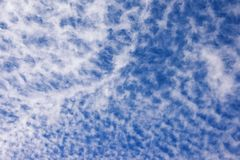 Background from the blue sky with white clouds. Blue sky and white clouds Cirrocumulus, high-altitude tropospheric clouds Stock Photos