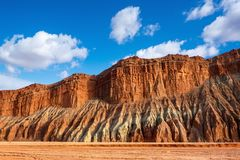 Blue sky white clouds and colorful Wensu Grand Canyon in Autumn. Wensu Grand Canyon in Wensu County, Northwest China`s Xinjiang Uygur Autonomous Region, is a stock photography