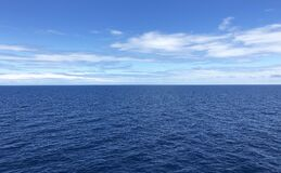 There is a sharp but fine line between the ocean and the sky.