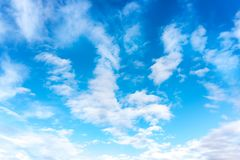 Blue sky with white clouds. Daytime and good weather royalty free stock photography
