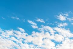Blue sky with white clouds. Daytime and good weather stock image