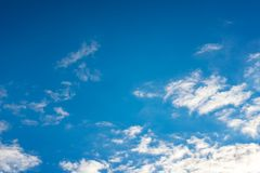Blue sky with white clouds. Daytime and good weather royalty free stock images