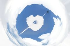 Blue sky and white clouds with distort coordinate filter. Blue sky and white clouds with distort coordinate filter and image of cloud heart and moving airplane stock photography