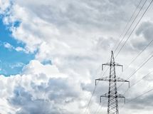 Blue sky white clouds electric power electricity wire. Transfer sunlight industry royalty free stock photography