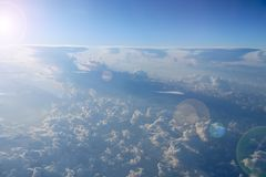 Blue sky with white clouds. Flight over clouds. Celestial abyss. Beautiful white clouds on blue sky. White clouds on summer sky. Celestial panorama. Sky stock photography