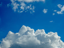 Blue Sky White Clouds Framed. Fluffy white clouds at bottom with clear blue sky on top royalty free stock photo