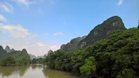 The blue sky and white clouds, green mountains and rivers royalty free stock image