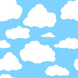Blue sky with white clouds. Hand drawn seamless pattern. Vector illustration in cartoon style.  Stock Photo