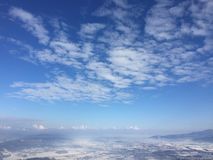 Blue sky and white clouds from high peak Royalty Free Stock Photo