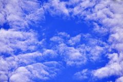 Blue sky with white clouds Looking at the sky. And beautiful royalty free stock photography