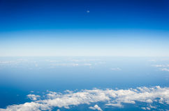 Blue sky, white clouds and moon. Royalty Free Stock Photo
