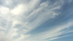 Blue sky with white clouds. White clouds move smoothly across the blue sky stock footage