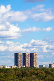 Blue sky with white clouds over apartment building Stock Photo