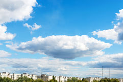 Blue sky with white clouds over the city Royalty Free Stock Photos